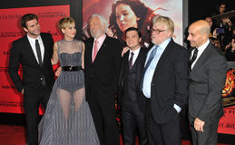 Jennifer Lawrence & Liam Hemsworth & Donald Sutherland & Josh Hutcherson & Philip Seymour Hoffman & Stanley Tucci Fotos de Stock