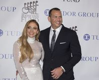 Jennifer Lopez and Alex Rodriguez. Actress, singer, dancer, and pop superstar Jennifer Lopez attends the 33rd Annual Great Sports Legends Dinner, at the New York stock photo