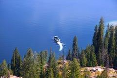 Jenny lake. Boat in Jenny lake at foot hills of Grand Tetons Royalty Free Stock Images