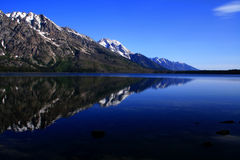 Jenny Lake Reflection. Early morning reflection on Jenny Lake, Grand Teton National Park, Wyoming Royalty Free Stock Image