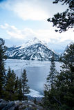 Jenny Lake. The scenery of Jenny Lake is partly covered with snow with pine forest and snowy mountains Stock Photography