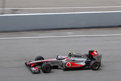 Jenson Button σε μια υψηλή ταχύτητα κατ' ευθείαν στοκ εικόνες