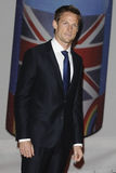 Jenson Button. Arriving for the Brit Awards 2012 at the O2 arena, Greenwich, London. 21/02/2012 Picture by: Steve Vas / Featureflash Royalty Free Stock Photo