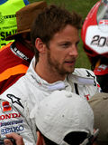 Jenson button british formula one champion. Jenson button - british formula one champion signing autographs Royalty Free Stock Image
