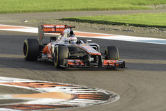 Jenson Button cornering a Vodafone Mclaren MP4-27 Royalty Free Stock Photography
