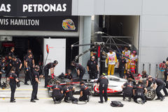 Jenson Button does a trial pit stop. British Jenson Button of McLaren having a trial pitstop during Friday practice at Petronas Formula 1 Grand Prix April 8 Royalty Free Stock Image