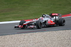 Jenson Button (GBR) in his McLaren in Germany. Jenson Button (GBR) testing and driving the McLaren Mercedes in practice 1, 07/22/2011 in the Germany Grand Prix N Stock Photography