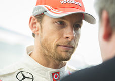 Jenson Button Mclaren. JEREZ (Spain) - FEBRUARY 11th: Jenson Button giving an interview at the first Test at the Jerez Circuit, Andalucia Spain 2013 Stock Photo