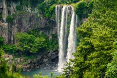 Jeongbang Waterfall on Jeju Island, South Korea.  royalty free stock photos