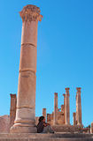 Jerash, the Gerasa of Antiquity, Jerash Governorate, Jordan, Middle East. Jordan, 04/10/2013: a tourist leaned to a Corinthian columns of the Temple of Zeus Stock Photos
