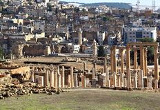 Jerash, Jordan. The ancient roman ruins of Jerash with the modern city in the background Stock Photos