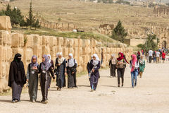 JERASH, JORDAN - APRIL 25, 2016: Young teens walking Royalty Free Stock Photos