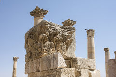 Jerash pillars. Old romans pillars and arch sculpture in Jerash, Jordan Royalty Free Stock Photo