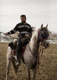 Jereed Rider. Jereed (Turkish: Cirit) is a traditional Turkish equestrian team sport played outdoors on horseback in which the objective is to score points by Royalty Free Stock Photo