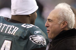 Jeremiah Trotter Jeffrey Lurie. Philadelphia Eagles linebacker Jeremiah Trotter and owner Jeffrey Lurie on the sidelines after a 2005 playoff victory Royalty Free Stock Photos