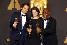 Jeremy Kleiner, Adele Romanski och Barry Jenkins royaltyfri bild