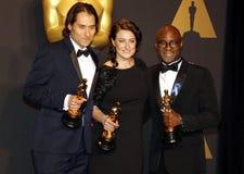 Jeremy Kleiner, Adele Romanski och Barry Jenkins royaltyfria foton