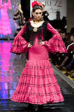 JEREZ DE LA FRONTERA, SPAIN - FEBRUARY 9: Models walk on the Carmen Vega catwalk during the Pasarela Flamenca Jerez 2014 Stock Photos