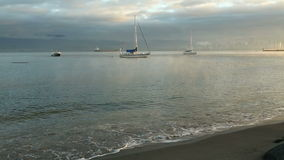 Jericho Beach, Morning Anchorage, Vancouver. Mist rises around anchored sailboats at dawn off Jericho Beach in English Bay, Vancouver, British Columbia, Canada stock video