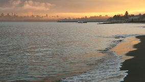 Jericho Beach, Winter Waves, Vancouver. A misty sunrise at Vancouvers Jericho Beach on English Bay. The Vancouver skyline is shrouded in fog. British Columbia stock footage