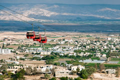 Cable car over Jericho. Jericho  is a Palestinian city located near the Jordan River in the West Bank. It is the administrative seat of the Jericho Governorate Stock Photo