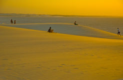 Jericoacoara sand dunes. Scenic view of people on yellow sand dunes with sea in background, Jericoacoara National Park, Ceara, Brazil Stock Photos