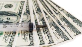 Jeringuilla en el dinero Fotos de archivo