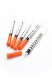 Jeringuillas de la insulina en el fondo blanco Imágenes de archivo libres de regalías