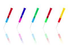 Jeringuillas médicas coloreadas   Imagenes de archivo