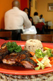 Jerk chicken plate Royalty Free Stock Photo