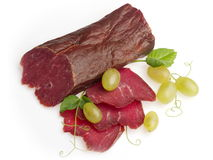 Jerked beef meat decorated with green grape Stock Photos