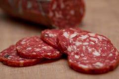Jerked Italian salami stock image