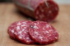 Jerked Italian salami stock photos
