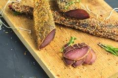 Jerky, basturma, dried meat beef, meat smoked jerky with spices stock photo