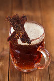 Jerky beef with beer - homemade dried cured spiced meat Stock Photography