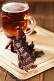 Jerky beef with beer - homemade dried cured spiced meat Stock Images