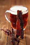 Jerky beef with beer - homemade dried cured spiced meat Royalty Free Stock Images