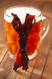 Jerky beef with beer - homemade dried cured spiced meat Royalty Free Stock Photography