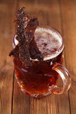 Jerky beef with beer - homemade dried cured spiced meat Stock Photos