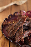 Jerky beef  cured spiced meat Royalty Free Stock Photo