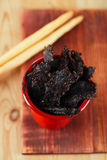 Jerky beef - homemade dry cured spiced meat Royalty Free Stock Image