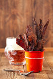 Jerky beef in orange dish - homemade dried cured spiced meat Stock Photography