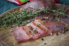 Jerky - homemade dry cured spiced meat. Royalty Free Stock Images