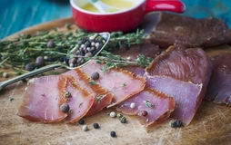 Jerky - homemade dry cured spiced meat. Royalty Free Stock Image