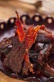 Jerky wołowina - domowej roboty suchy leczący spiced mięso Zdjęcie Stock