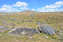 Jermuk, Armenia, mountain plateau near Jermuk with stones with petroglyphs of the 7th century BC Royalty Free Stock Photography