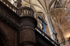 Jeronimos Monastery interior. Lisbon, Portugal - March 5, 2014: Christ, celling and column from Manueline style interior of Jeronimos Monastery, Belem Stock Photography