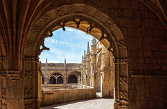 Jeronimos Monastery, Lisbon, Portugal. Couple of tourists in famous Unesco Heritage Jeronimos Monastery in Lisbon, Portugal Royalty Free Stock Image