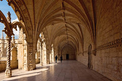 Jeronimos Monastery, Lisbon, Portugal. Couple of tourists in famous Unesco Heritage Jeronimos Monastery in Lisbon, Portugal Stock Images