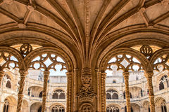 Jeronimos Monastery, Lisbon, Portugal. Tourists in famous Unesco Heritage Jeronimos Monastery in Lisbon, Portugal Royalty Free Stock Images